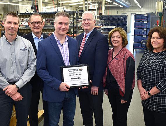 Enterprise Minnesota presents ISO 9001:2015 plaque to Liberty Clark, Inc.