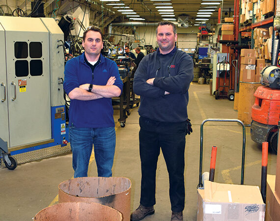 Western Spring brothers pose in their manufacturing facility