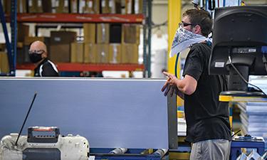 North Central Door - worker moving door