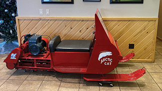 Ericco display of an early Arctic Cat snowmobile