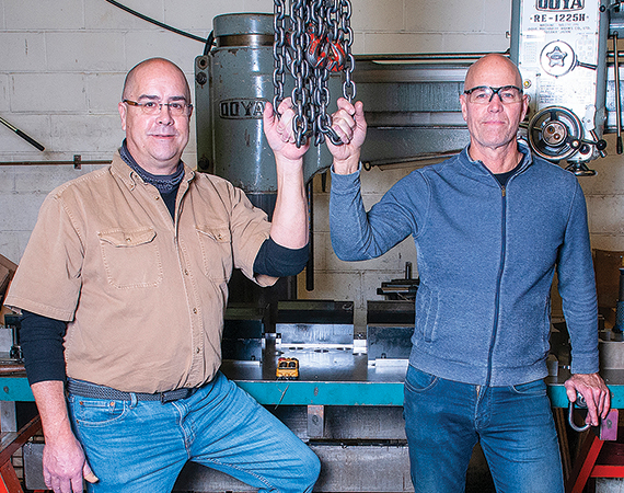 MN Tool and Die Works president and vice president standing in their factory